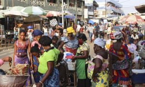 Daily life in Togo continues at a market in Lome, with some wearing face masks, back in December.