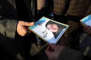 An Iranian man hands out leaflets for reformist candidate Parvaneh Salahshori in the upcoming parliamentary elections.