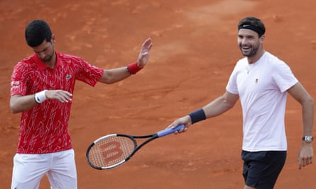 Bulgaria's Grigor Dimitrov, right, speaks with Serbia's Novak Djokovic during a 'rolling' tennis doubles match of the Adria Tour charity tournament, in Belgrade, Serbia.