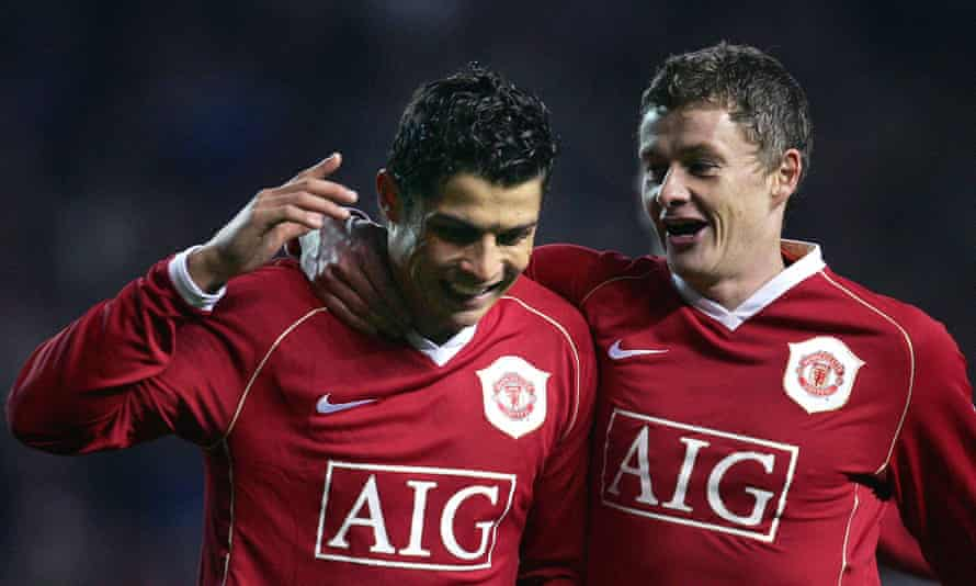 Cristiano Ronaldo celebrates with Ole Gunnar Solskjaer after scoring a rebounded penalty against Wigan in 2006.