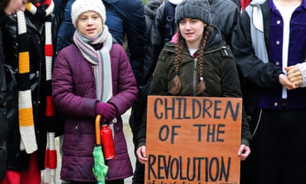 Greta Thunberg (L) takes part in a protest on 5 March, 2020.