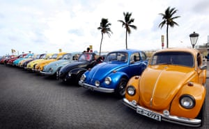Colombo, Sri Lanka. Classic and custom-built Volkswagen Beetles, which have been gathered together to celebrate World Volkswagen Day at Hotel Galle Face. The Beetle has been a popular car on the island for decades. Many of the Beetles have had only one owner or been passed down to the younger generation