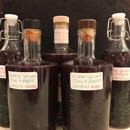 Bottles of homemade sloe cordial