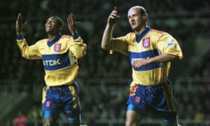 Lombardo celebrates with Marcus Bent after scoring against Newcastle at St. James Park in 1998.