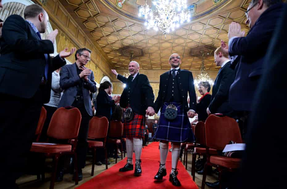 Malcolm Brown (left) and Joe Schofield marry just after midnight on 31 December 2014 in one of the first same-sex marriages to take place in Scotland.
