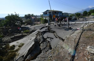 A damaged road is seen at the Balaroa village in Palu.