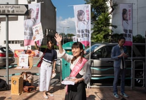 Pro-democracy candidate Clarisse Yeung canvasses for votes in the Wan Chai district of Hong Kong.
