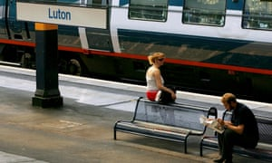 Commuters wait for their train on the platform at Luton train station
