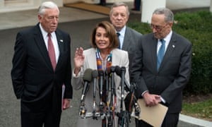 Nancy Pelosi, standing with Steny Hoyer, Dick Durbin and Chuck Schumer, speaks to reporters at the White House after meeting with Donald Trump on 2 January.
