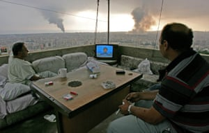 Beirut, 2006Lebanese citizens watch Hezbollah leader Sheik Hassan Nasrallah speak on television as black smoke rises from new Israeli attacks on the group's stronghold in the southern suburbs of the city