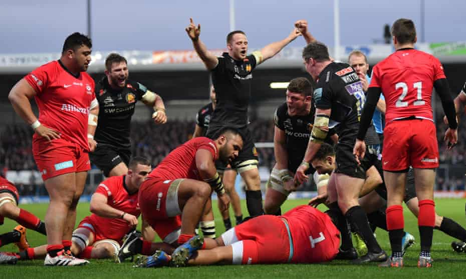 Exeter celebrate as Jacques Vermeulen (hidden) dives over to score his side's second try against Saracens in December 2019.