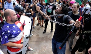 White supremacists and neo-Nazis exchange insults with anti-fascist protesters at last year's rally in Charlottesville, Virginia.