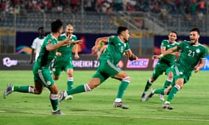 Algeria's forward Youcef Belaili (centre) celebrates with his teammates after scoring.