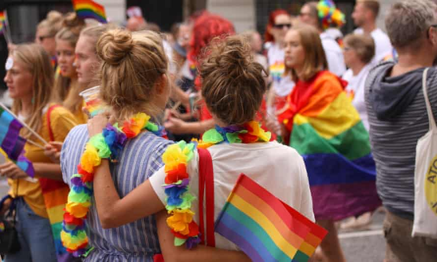 Two women with arms around each other at Copenhagen's annual Pride parade in 2018.