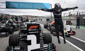 Lewis Hamilton of Britain jumps out of his car after his record-breaking win.