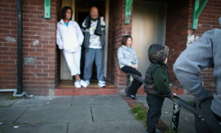 A family outside their council home in Salford, Manchester