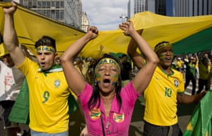 """<strong>Sao Paulo </strong>Demonstrators shout anti-government slogans as they march holding a giant flag with the word """"Impeachment"""" written on it"""