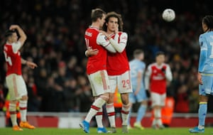 Arsenal's Rob Holding and Matteo Guendouzi embrace at full time.