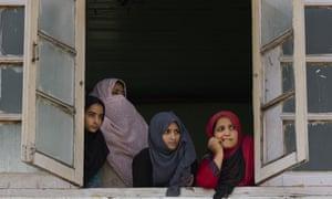 Women look out of a window in Srinagar, Kashmir