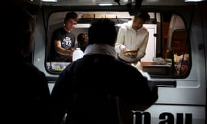 Homeless people line up at a Darlinghurst food van