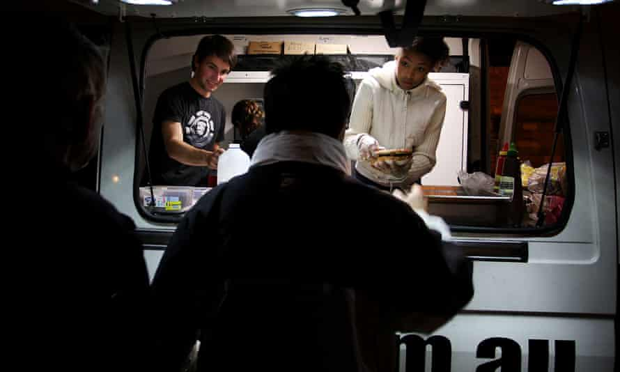 Homeless people line up at a Darlinghurst food van