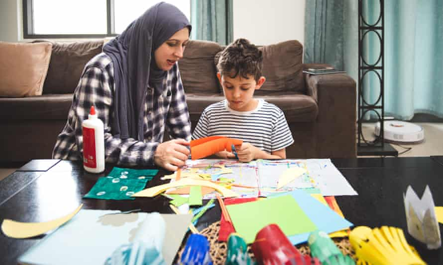 Mother and child doing creative activities together
