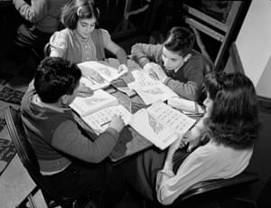 Turkish American children at table with workbooks, ca. 1940
