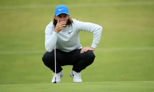 Tommy Fleetwood lines up a putt on the 11th green during the third round of the Open. His 66 put him four shots behind leader Shane Lowry.