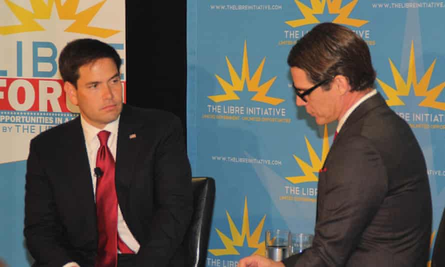 Rubio speaks with Daniel Garza, executive director of the Libre Initiative, in Las Vegas.