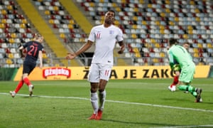 Marcus Rashford looks dejected after his shot is saved by Croatia's Dominik Livakovic, the second of two glorious chances missed by the England forward.