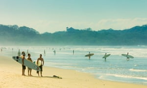 Surfers on Playa Guiones beach, Nosara, Nicoya Peninsula, Costa Rica