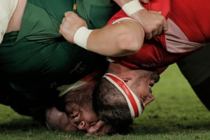 Props Frans Malherbe and Wyn Jones hit the floor as a scrum collapses during the semi-final which the Springboks won by just three points.