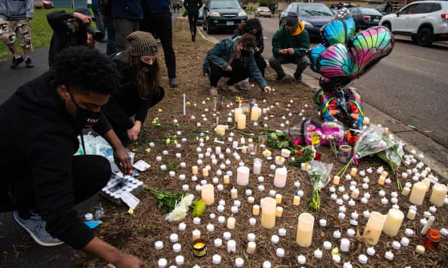 Daunte Wright's family, friends and the community attend a vigil in his honor on 12 April.