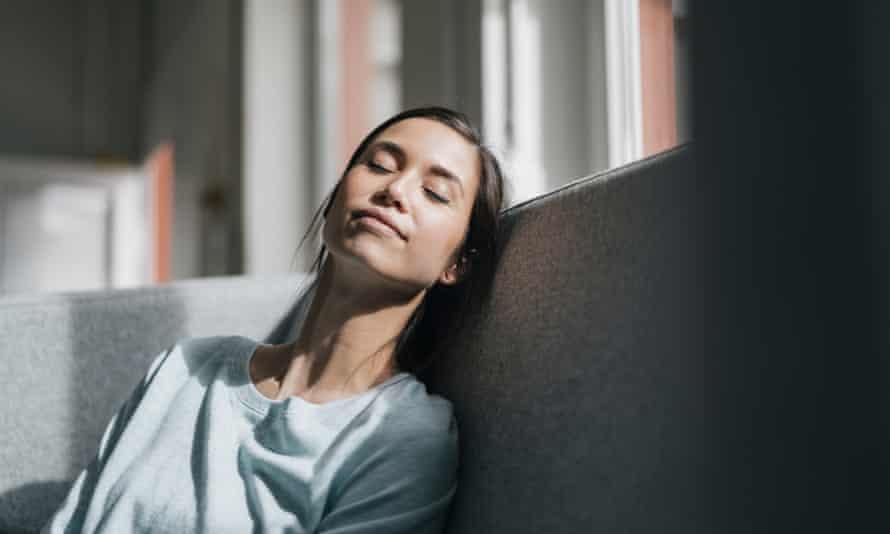 A woman takes a daytime nap.