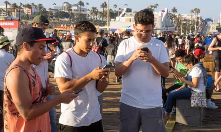 Pokemon Go players on the Santa Monica Pier.
