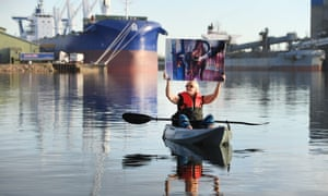 A live export protester awaits the arrival of livestock carrier Bader III in Port Adelaide.