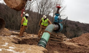 Men with Cabot Oil and Gas work on a natural gas valve at a hydraulic fracturing site on 18 January 2012 in South Montrose, Pennsylvania.