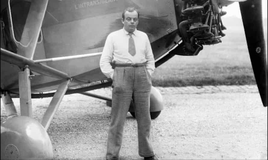 Antoine de Saint-Éxupery posing in front of his plane. S