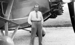 The French writer and aviator Antoine de Saint-Exupéry posing in front of his plane.