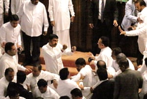 Government and opposition members confront each other in parliament
