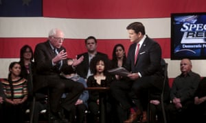 Bernie Sanders talks with moderator Bret Baier during the Democratic town hall.
