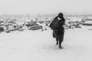 A woman walks through snow during a blizzard in November 2016