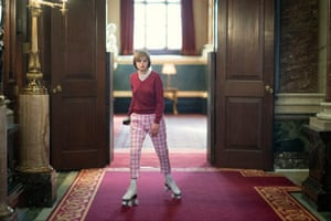 Emma Corrin as Princess Diana roller-skates through the Buckingham Palace state rooms in The Crown.