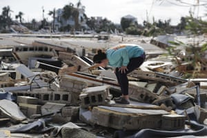Mishelle McPherson looks for her friend in the rubble of her home, since she knows she stayed behind in the home in Mexico Beach