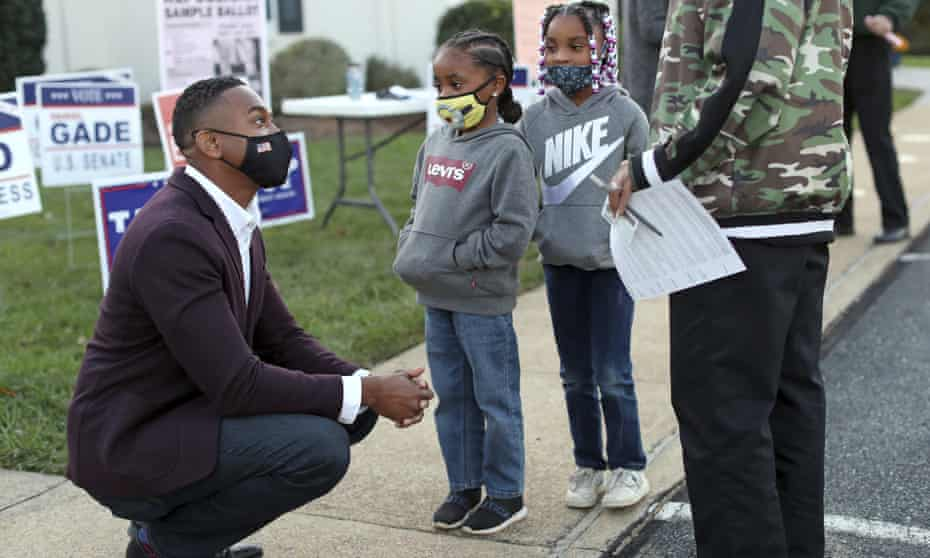 Webb speaks with six-year old twins Justyn and Justyce Bryant and their mother, Minnie Tyler, outside a voting location in Charlottesville.