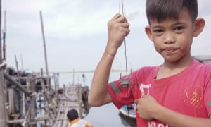 A child hunts the crab with the catapult in Kamal Muara, the last fishing village nearby reclamation island 'D', DKI Jakarta, Indonesia on October 10, 2016.