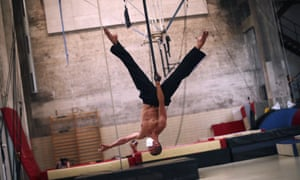 A student practises his routine during a class at the newly reopened Superior School of Circus in Brussels, Belgium.