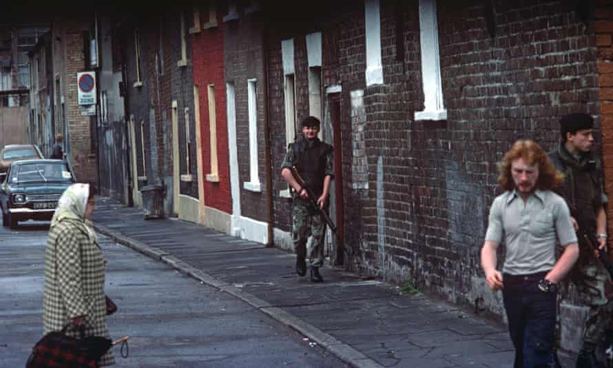 British army soldiers patrolling streets of nationalist west Belfast during the Troubles in Northern Ireland.