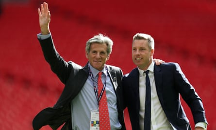 Millwall's owner, John Berylson, pictured here celebrating promotion to the Championship with the manager Neil Harris, right, said he welcomed the end of the legal dispute.