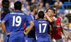 Arsenal defender Gabriel reacts after being sent off against Chelsea, while Diego Costa watches on.